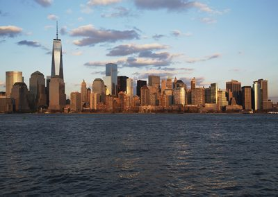 Panoramic view of New York City Skyline on water featuring One World Trade Center (1WTC), Freedom Tower, New York City, New York, USA